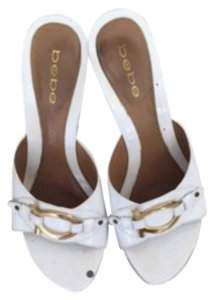 bebe White &gold embelishment Wedges