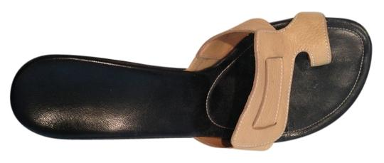 Other tan, black Mules