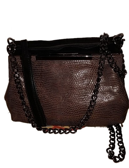 Preload https://item5.tradesy.com/images/foley-corinna-brown-and-black-suede-snakeskin-embossed-leather-clutch-4591264-0-0.jpg?width=440&height=440