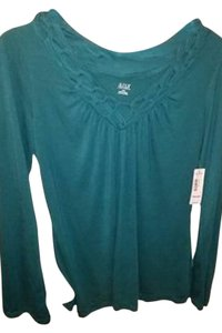 a.n.a. a new approach Top teal green