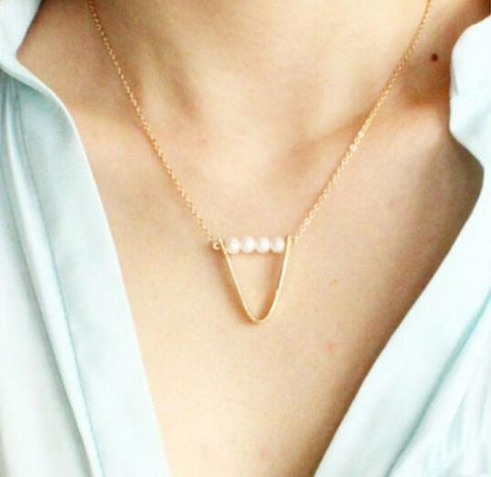 Preload https://item5.tradesy.com/images/gold-charming-pearl-traingle-loop-necklace-4660084-0-0.jpg?width=440&height=440