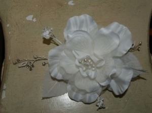 A Silk Ivory Flower With Comb For The Brides Hair