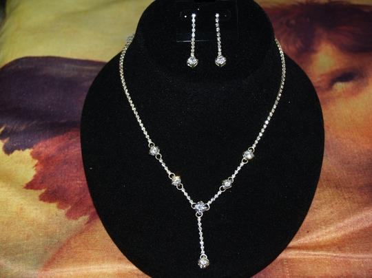 Preload https://img-static.tradesy.com/item/46894/crystals-necklace-and-matching-earrings-set-rb9-46894-0-0-540-540.jpg