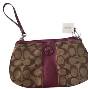 Coach Wristlet in Brown And Purple