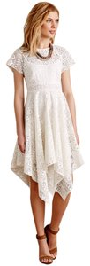 Maeve short dress White Lace Anthropologie Asymmetric on Tradesy