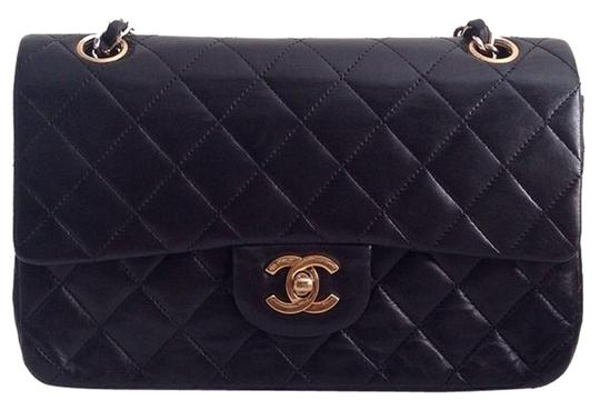 Preload https://item4.tradesy.com/images/chanel-classic-flap-medium-with-gold-hardware-black-lambskin-shoulder-bag-4721848-0-0.jpg?width=440&height=440