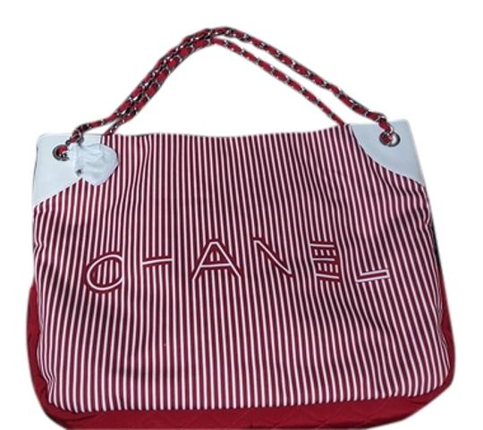 Preload https://item3.tradesy.com/images/chanel-new-with-tags-2010-cruise-large-red-rialto-hand-bag-beach-bag-canvas-leather-trim-tote-4728277-0-3.jpg?width=440&height=440
