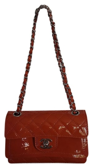 Preload https://img-static.tradesy.com/item/4740076/chanel-new-with-tags-dark-orange-patent-4-holes-mini-double-flap-hand-2006-leather-cross-body-bag-0-0-540-540.jpg