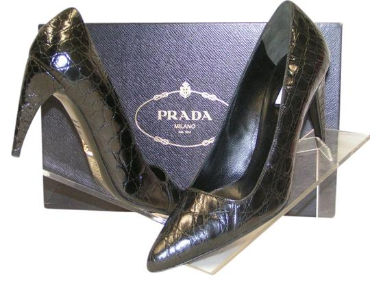 Preload https://item3.tradesy.com/images/prada-black-crocodile-leather-curve-heel-classic-pointed-75-pumps-size-eu-38-approx-us-8-regular-m-b-4748962-0-0.jpg?width=440&height=440