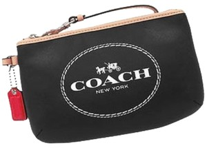 Coach Wristlet in Black With Tan Trim