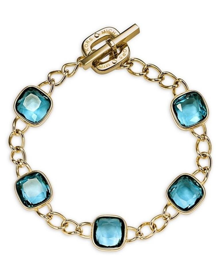 Michael kors gold and blue bracelets 40 off michael for Michael b jewelry death