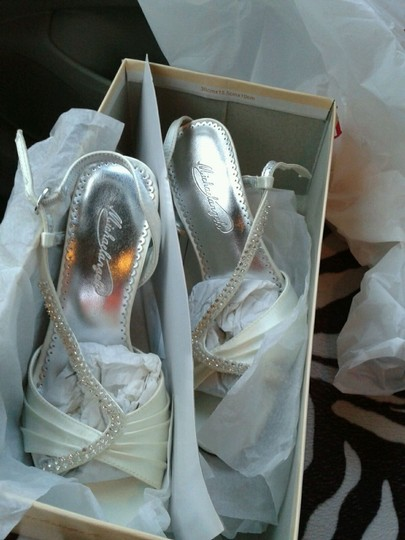 Preload https://img-static.tradesy.com/item/48017/dyeables-ivory-asymetrical-crystal-sandal-style-lizzy-size-us-65-0-0-540-540.jpg