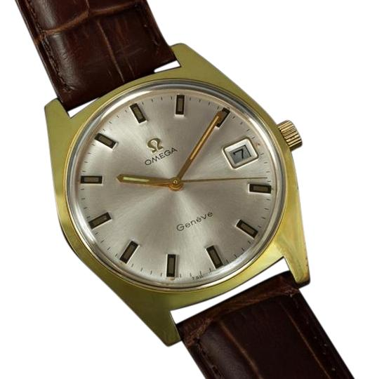 Preload https://item2.tradesy.com/images/omega-silver-1970-geneve-vintage-tropical-mens-date-gold-plated-and-stainless-steel-watch-4811026-0-0.jpg?width=440&height=440
