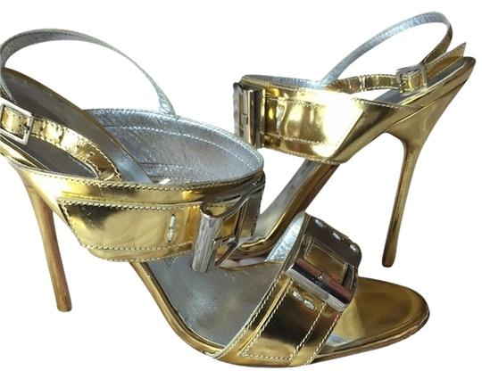 Preload https://item2.tradesy.com/images/manolo-blahnik-gold-and-silver-goldsilver-buckle-sandals-size-us-75-regular-m-b-4814881-0-0.jpg?width=440&height=440