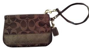 Coach Dark Wristlet in brown