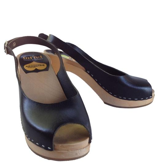 Preload https://item2.tradesy.com/images/swedish-hasbeens-new-t-strap-sky-high-black-with-black-heel-mulesslides-size-us-65-4824136-0-0.jpg?width=440&height=440