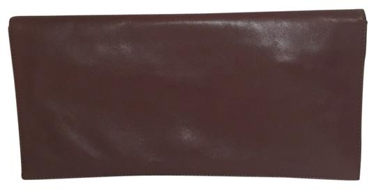 Preload https://item4.tradesy.com/images/calvin-klein-brown-leather-clutch-4824298-0-0.jpg?width=440&height=440