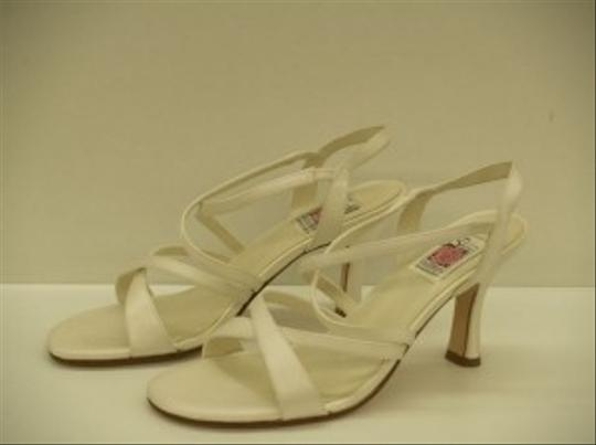 Preload https://item5.tradesy.com/images/special-occasions-by-saugus-shoe-diamondsilk-white-18010-strappy-open-toe-destination-beach-cruise-w-48369-0-1.jpg?width=440&height=440