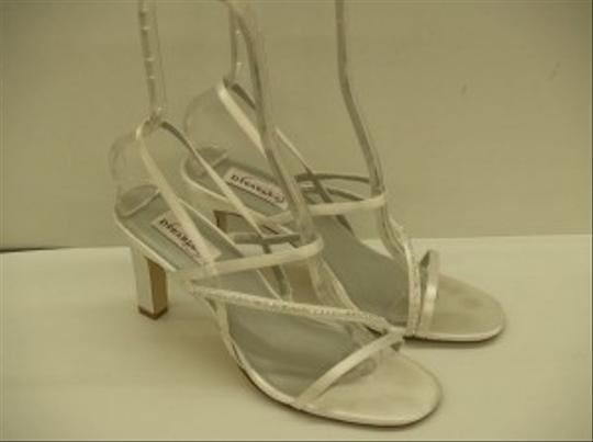 Preload https://item5.tradesy.com/images/dyeables-white-aurora-strappy-destination-cruise-wear-satin-sandals-size-us-9-48489-0-0.jpg?width=440&height=440