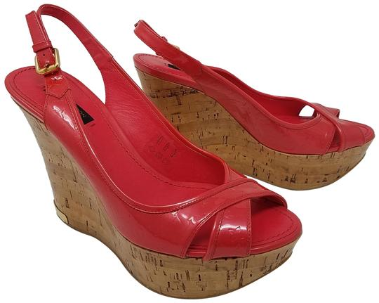 Preload https://img-static.tradesy.com/item/4860508/louis-vuitton-red-gold-patent-leather-lv-monogram-wedges-sandals-size-eu-385-approx-us-85-regular-m-0-9-540-540.jpg
