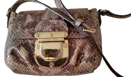 Preload https://item3.tradesy.com/images/michael-kors-brown-python-embossed-leather-cross-body-bag-4863127-0-0.jpg?width=440&height=440