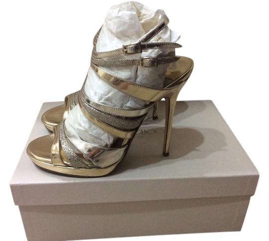 Preload https://item4.tradesy.com/images/jimmy-choo-gold-mirror-glitter-sandals-size-us-65-4915123-0-0.jpg?width=440&height=440