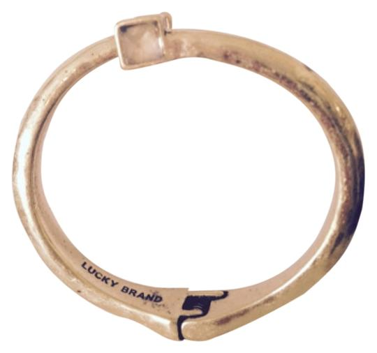 Preload https://item4.tradesy.com/images/lucky-brand-cleargold-bracelet-4944373-0-0.jpg?width=440&height=440