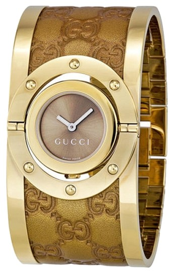 Preload https://item2.tradesy.com/images/gucci-gucci-ladies-watch-gold-tone-with-logo-embossed-leather-cuff-watch-4946731-0-0.jpg?width=440&height=440