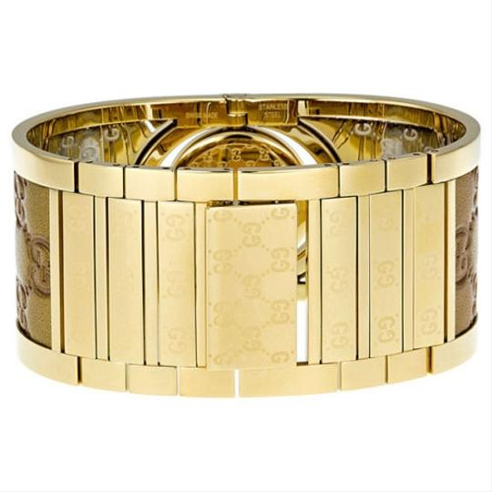 Gucci Gucci Ladies Watch Gold Tone with Logo Embossed Leather Cuff Watch
