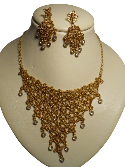 Preload https://img-static.tradesy.com/item/4961554/gold-tone-bib-rhinestone-and-earrings-necklace-0-0-540-540.jpg