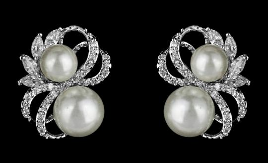 Preload https://img-static.tradesy.com/item/4966570/soft-cream-classic-cz-and-pearl-earrings-0-0-540-540.jpg