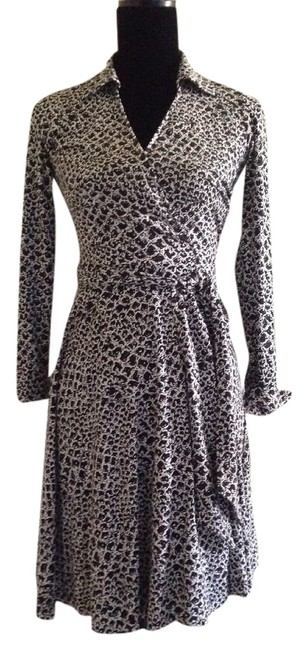 Preload https://item1.tradesy.com/images/diane-von-furstenberg-black-and-white-t72-wrap-in-dotted-snake-knee-length-workoffice-dress-size-2-x-4980280-0-0.jpg?width=400&height=650