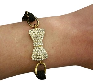 Bow bracelet with black and gold