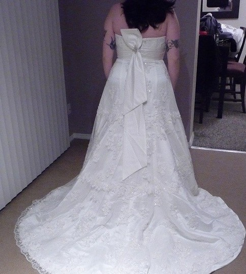Preload https://item2.tradesy.com/images/oleg-cassini-ivory-lace-cwg365-traditional-wedding-dress-size-14-l-49921-0-0.jpg?width=440&height=440