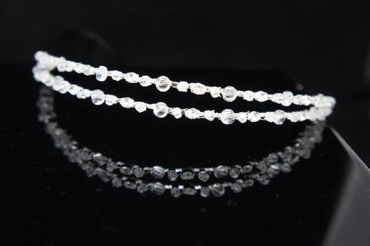 Preload https://item3.tradesy.com/images/clearrhodium-plate-2-tier-crystal-headband-tiara-hair-accessory-50137-0-0.jpg?width=440&height=440