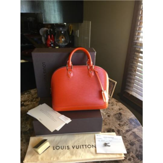 Louis Vuitton Wristlet in chili red/piment