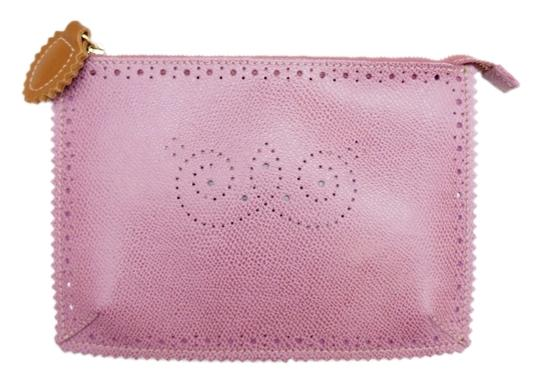 Preload https://item5.tradesy.com/images/furla-new-mauve-laser-cut-pouch-cosmetic-travel-purple-leather-clutch-5018674-0-0.jpg?width=440&height=440