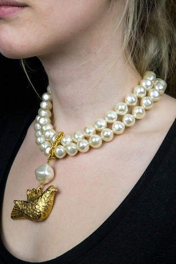 Dominique Aurientis DOMINIQUE AURIENTIS Two Strand Baroque Faux Pearl Bird Pendant Necklace