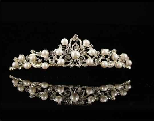 Preload https://img-static.tradesy.com/item/50244/ivoryother-crystal-with-faux-pearls-tiara-0-0-540-540.jpg
