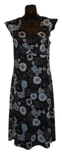 BCBGMAXAZRIA short dress Black Floral Floral Black Empire Waist Wrap on Tradesy