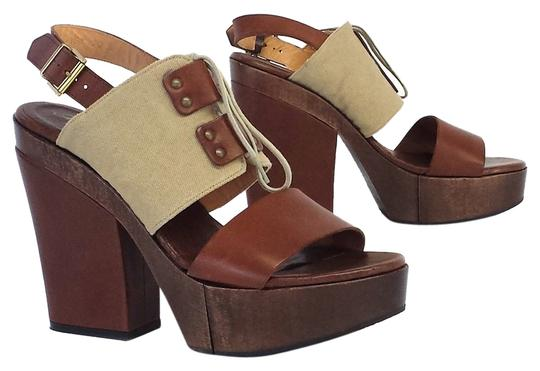 Preload https://item4.tradesy.com/images/robert-clergerie-brown-and-beige-leather-heels-platforms-size-us-8-5042278-0-0.jpg?width=440&height=440