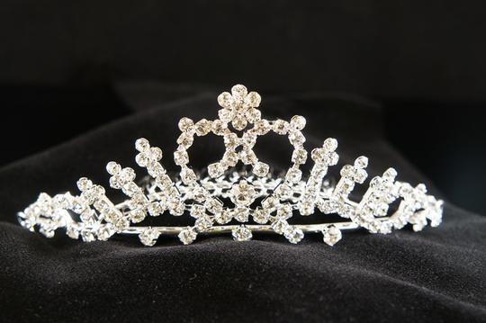 Preload https://item4.tradesy.com/images/silverrhodium-plate-rhinestone-heart-tiara-flower-girl-accessory-50488-0-0.jpg?width=440&height=440