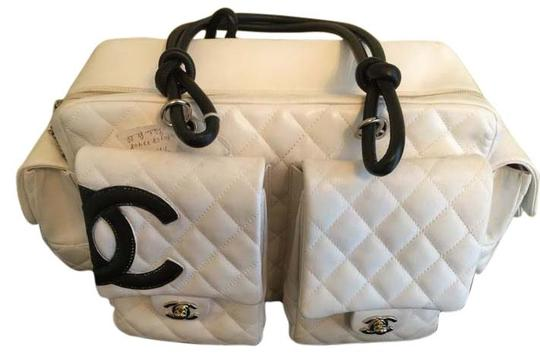 Preload https://item2.tradesy.com/images/chanel-9583075-white-and-black-genuine-leather-shoulder-bag-5062771-0-0.jpg?width=440&height=440