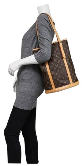 Preload https://item2.tradesy.com/images/louis-vuitton-marais-bucket-gm-monogram-usps-brown-free-2-day-shipping-canvas-shoulder-bag-5065861-0-2.jpg?width=440&height=440