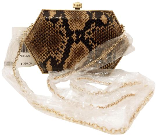 Preload https://img-static.tradesy.com/item/5073541/be-and-d-be-and-d-snake-embossed-brown-leather-clutch-0-6-540-540.jpg