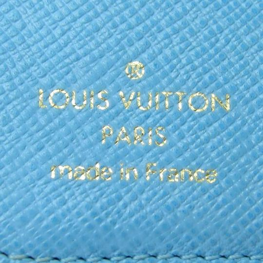 Louis Vuitton Authentic Louis Vuitton Monogram Groom/Porter Illustre Compact Zip Wallet