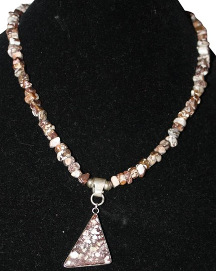 Preload https://item5.tradesy.com/images/brown-and-white-artisan-made-sterling-silver-statement-using-leopard-skin-rhyolite-beads-necklace-510329-0-0.jpg?width=440&height=440