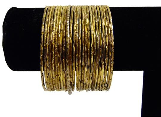 Preload https://img-static.tradesy.com/item/5103697/goldtone-glitter-24-piece-bangle-set-size-medium-bracelet-0-0-540-540.jpg