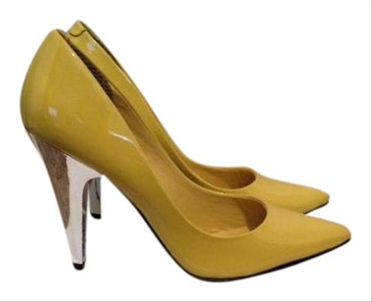 Preload https://item4.tradesy.com/images/steve-madden-yellow-luminate-patent-pumps-size-us-55-regular-m-b-511713-0-0.jpg?width=440&height=440