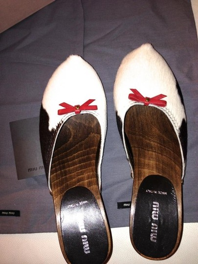 Miu Miu Heels Platform Wooden Wood Leather Designer Italy Italian Ponyhair Fur Chloe Celine Saint Laurent Luxe Luxury Louis Bow brand new in box cow print (pony hair) AUTH Mules